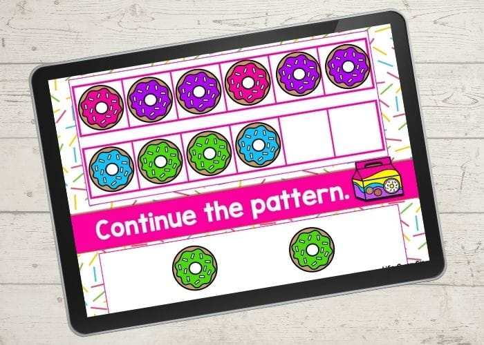 The digital donut theme ABB pattern activity slide for the patterns pink-purple-purple completed.
