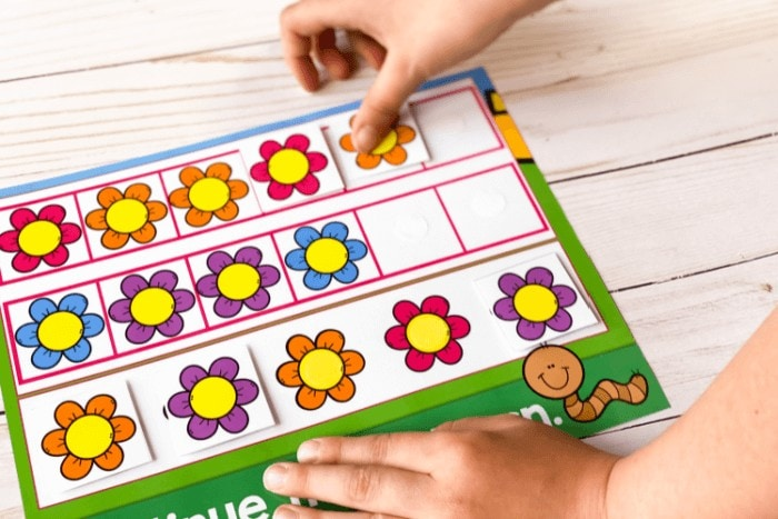 A child completing the printable spring ABB pattern activity.